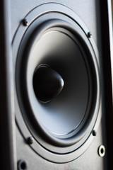 Powerful audio system. Closeup view of black bass power speaker