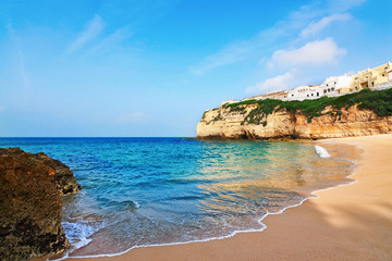 Portuguese villa in Carvoeiro beach with clear blue sea. Summer.