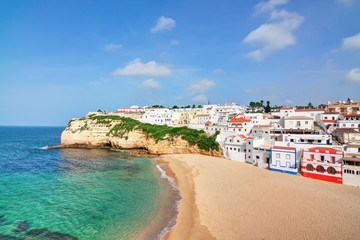 Portuguese villa in Carvoeiro beach with clear blue sea. In the