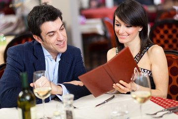 Couple choosing on the menu in a restaurant