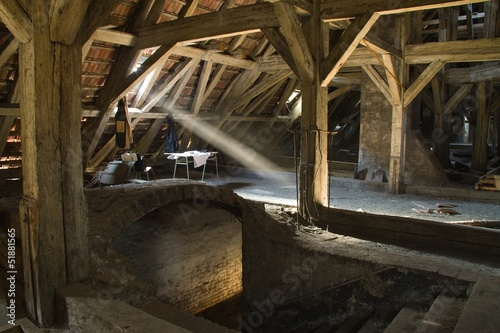 beam of light shines on the old ground, the old attic