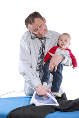 man is ironing,speaking on phone and holding baby