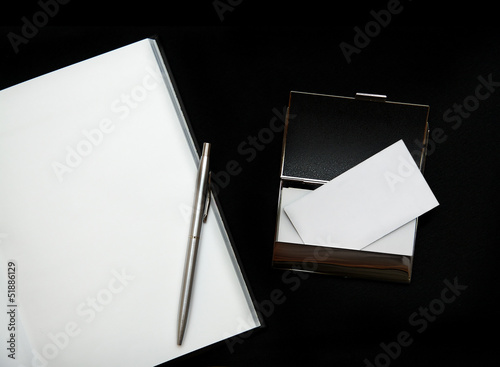 Blank business cards and notebook