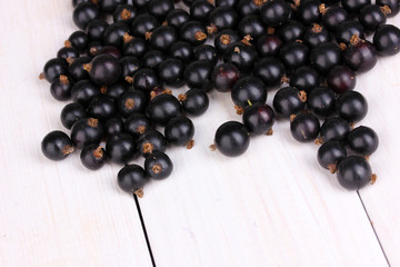Black currant on wooden background