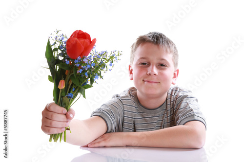 Happy teenager with bouquet of flowers