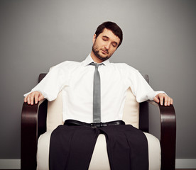 fatigued businessman on the armchair