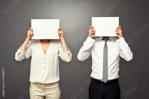 man and woman hiding their faces