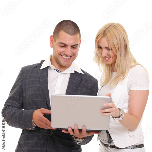 Happy man and woman looking at something on the laptop