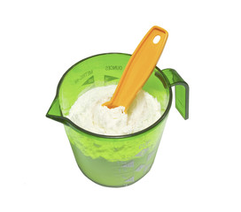 gren measuring cup with one tsp.,measuring spoon, isolated