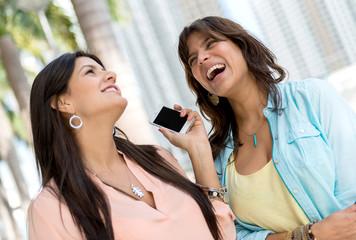 Happy women on the phone