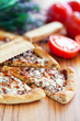 Pizza with tomato sauce, basil and cheese, selective focus