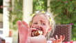 Girl Eating Messy Slice Of Chocolate Cake