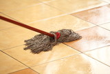 cleaning the floor with a mop