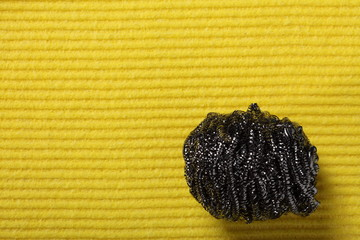yellow sponge background and steel scourer