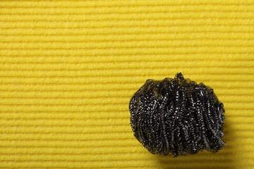 yellow sponge background and steel scourer