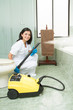 cleaning lady  with steam machine, logos removed