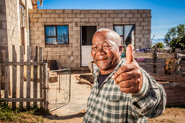 Coloured retired man very  positive