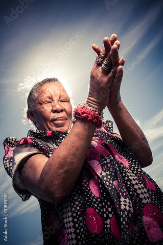 Coloured woman praying  for better days
