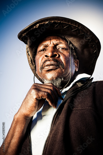 old african farmer with cowboy hat