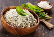 Risotto with spinach in wooden bowl
