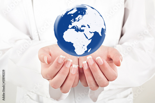 doctor woman holding globe on her hands