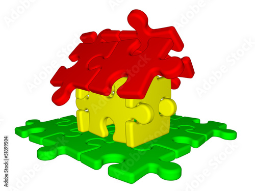 House made from puzzle isolated on white background