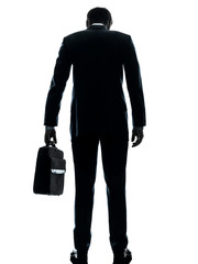 business man sad standing rear view silhouette