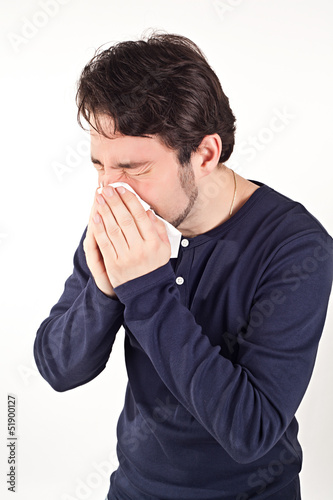 Man with cold holding tissue