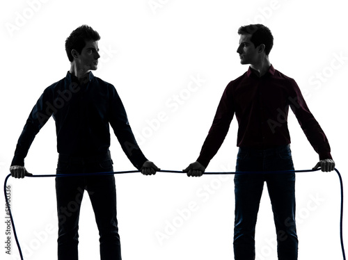 two  men twin brother friends tug of war silhouette