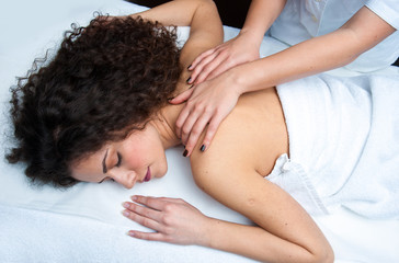 woman having back adjustment