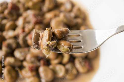 close up of a fork with beans