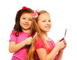 Two girls brushing hair
