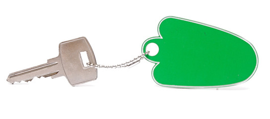A green blank key tag with silver key on white background
