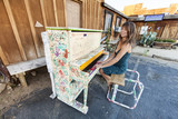 Playing piano outdoors.