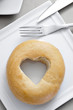 bagel with a heart-shaped hole