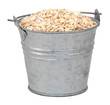 Porridge oats in a miniature metal bucket