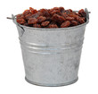 Raisins in a miniature metal bucket