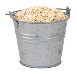 Porridge oats in a miniature metal bucket