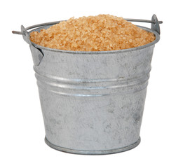 Demerera sugar in a miniature metal bucket