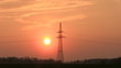 Sunset with electrical pylon (time lapse)