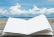 Open book with big cloud and sea background