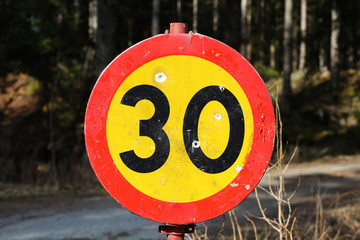 Sweedish bullet holed speed limit sign. Max 30.
