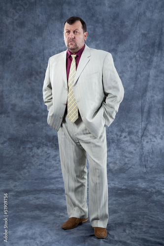 portrait standing mafia boss showing thumbs