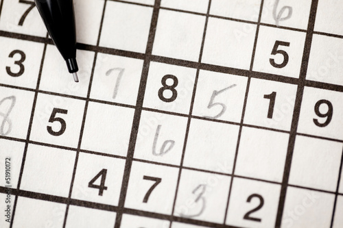 Sudoku puzzle and pencil