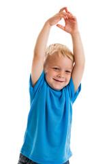 Preschool boy raising arms in the air