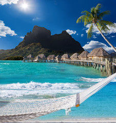 palms , hammock and ocean. Bora-Bora. Polynesia