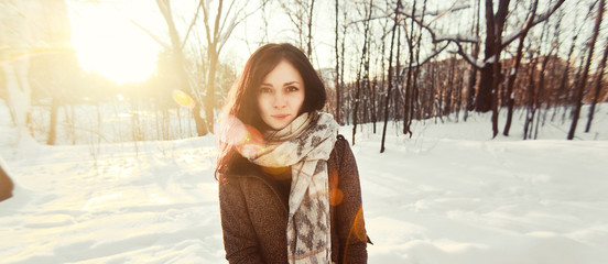 beautiful young girl enjoying a sunny winter day