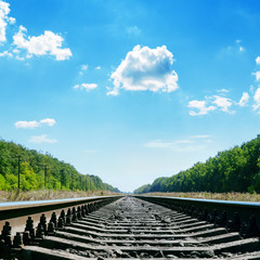 railroad close up to horizon and cloudy sky