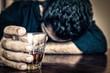 Leinwanddruck Bild - Drunk man holding a drink and sleeping on a table