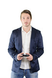 Young man standing, with videogame joypad in his hands poster